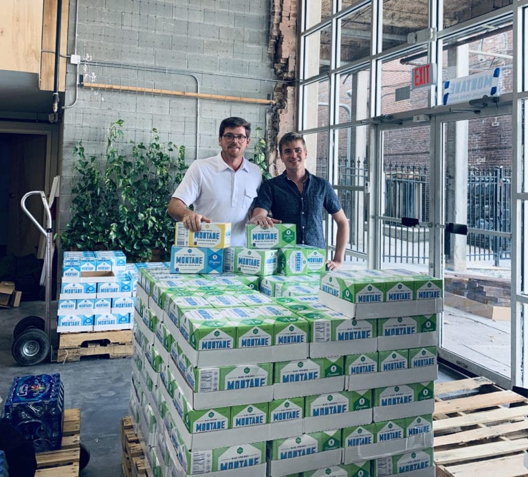 Ben Stowers with a pallet of montane water